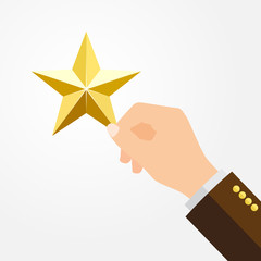 Businessman holds a big yellow star