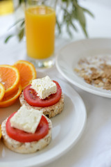 Morning breakfast with breads,tomatoes and orange juice