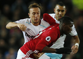 Manchester United's Paul Pogba in action with West Ham United's Mark Noble