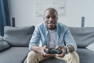 African american man playing with joystick 997c89bb9