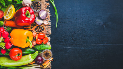 Wall Mural - Frame of organic food. Fresh raw vegetables and spices. On a wooden chalkboard.