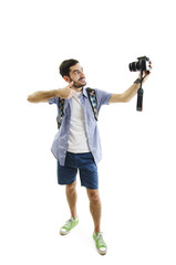Travel concept. Full length studio portrait of handsome young man taking selfie. Isolated on white background