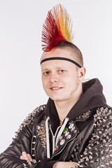 Portrait of punk rocker with Mohawk hairstyle on a white background.