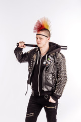 punk rocker with Mohawk hairstyle holding baseball bat on a white background.