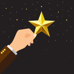 businessman hand picking up a star