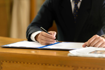 business man signing contract document in office