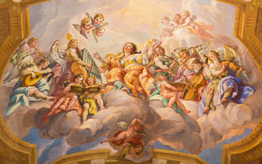 VIENNA, AUSTRIA - JULY 30, 2014: The symbolic fresco of woman wiht the angels and music instruments in baroque church of St. Charles Borromeo by Johann Michael Rottmayr.