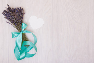 Lavender desk design with flowers on white background top view mock up. White paper postcard heart