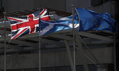 The Union flag,The Scottish Saltire and The European flag fly at the Scottish Parliament in Edinburgh Scotland