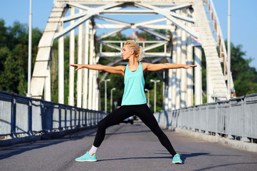 Warrior yoga pose over steel bridge background