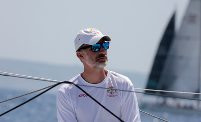 "Spain's King Felipe sits on board the ""Aifos"" yacht during the 36th King's Cup yachting race in Palma de Mallorca"