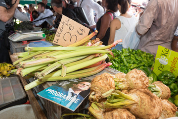 A copy of his program is seen amongst vegetables as Emmanuel Macron, head of the political movement En Marche ! (Onwards !) and 2017 presidential candidate visits the Chaudron market in Saint-Denis