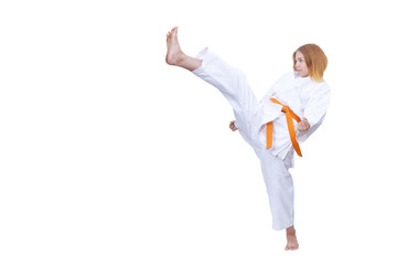 Adult girl athlete beats kicking against white background