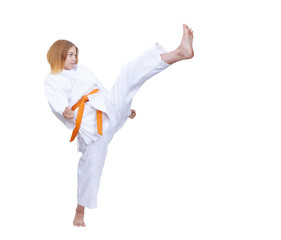 Athlete trains a kick on a white background isolated