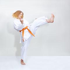 Blow leg girl is training with an orange belt