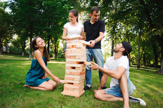 Jenga, group game of physical skill with big blocks.