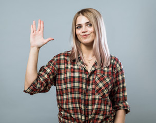 Young woman with hello sign