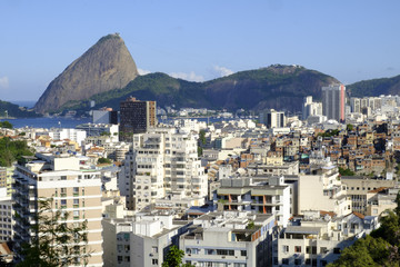 View of a favela with the Sugar Loaf in the background, Rio de Janeiro, Brazil, South America