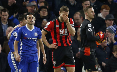 Bournemouth's Simon Francis reacts after fouling Chelsea's Eden Hazard and a penalty is awarded to Chelsea