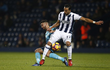 West Brom's Nacer Chadli in action with Swansea's Neil Taylor