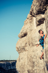 Men climbs a rock
