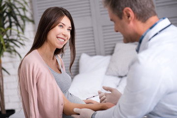 Attractive longhaired woman smiling to her doctor