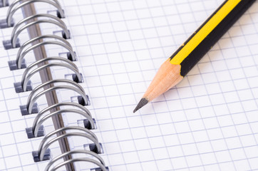 Close up of a Pencil on a Open Notebook