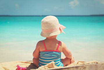 cute little girl play on beach