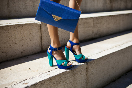 woman with a shoes and bag in a urban outdoor