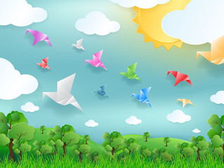 Paper of Bird flying concept . color paper bird fly on blue sky , sun , grass and cloud. Vector paper art style