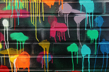 Colorful blotches of paint on a wall