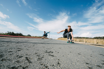 Couple on Skateboards