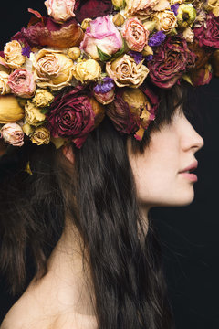 Close-up of young woman wearing dried flower wreath