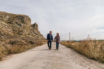 Mid Adult Couple in a Desertic Landscape