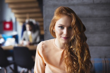 Ginger Woman in a Bar