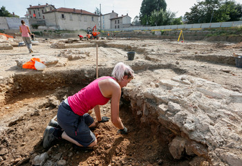 An archaeologist works during the excavation of an ancient Roman neighborhood on a site awaiting construction in Sainte-Colombe