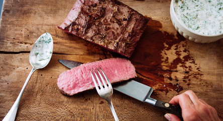 Cutting roast beef cooked medium rare