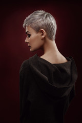 Beautiful young woman with short grey hair