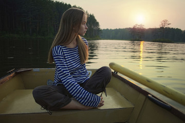 Woman on boat during sunset