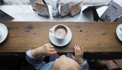 Girl tasting  coffee at restaurant
