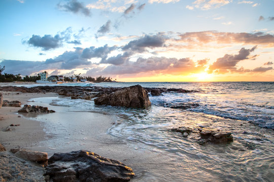 Sunset beach with dramatic rocks in low tide on the Bahama Island