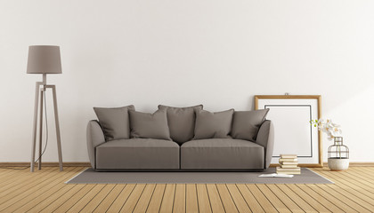 White room with brown sofa