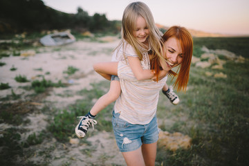 Child goes on mother's back