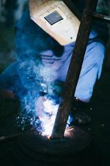 Welder welding outdoors