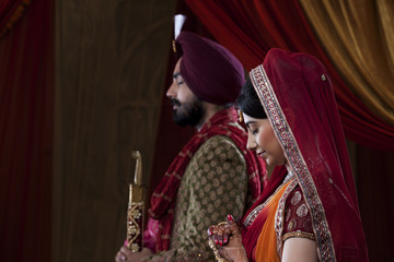 Side view of couple with eyes closed on their wedding day