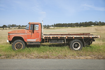 Old pick up / flat tray truck on the side of a country road in Australia