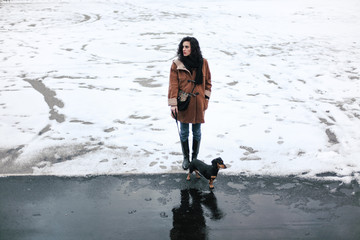 Woman and her little dog, snow