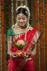 Smiling bride holding kalash