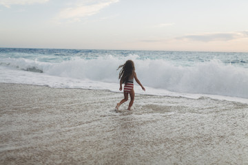 Girl playing on the waves.