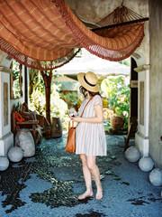 Woman walking under hammock